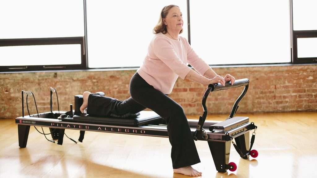 Older female exercising on Pilates Allegro Reformer