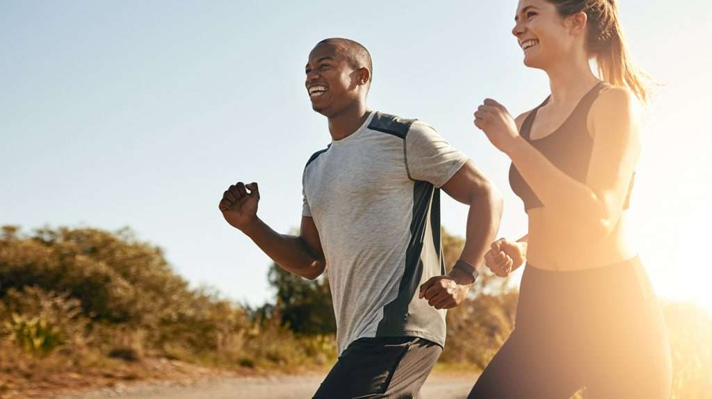 Shot of a fit young couple going for a run outdoors